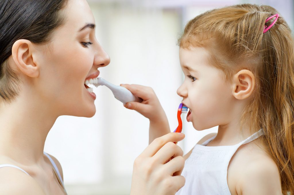 mother and daughter brush my teeth