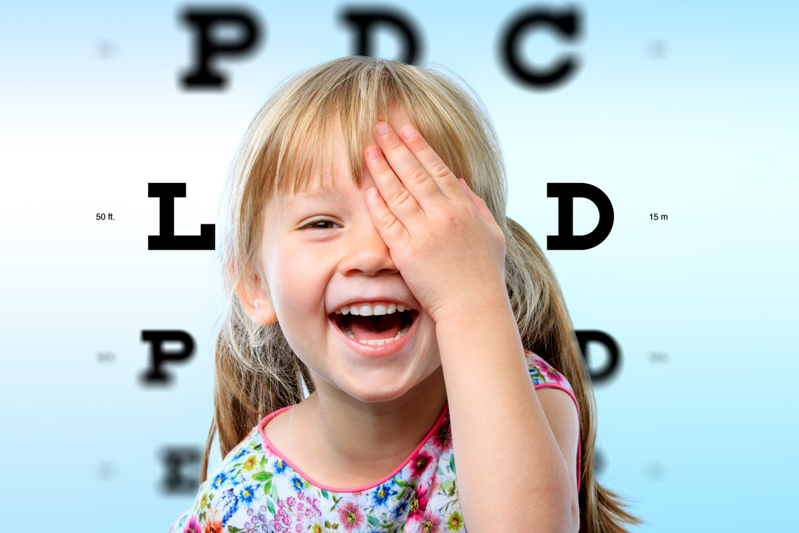 close-up-face-portrait-of-happy-girl-having-fun-at-vision-test-conceptual-image-with-girl-closing-on