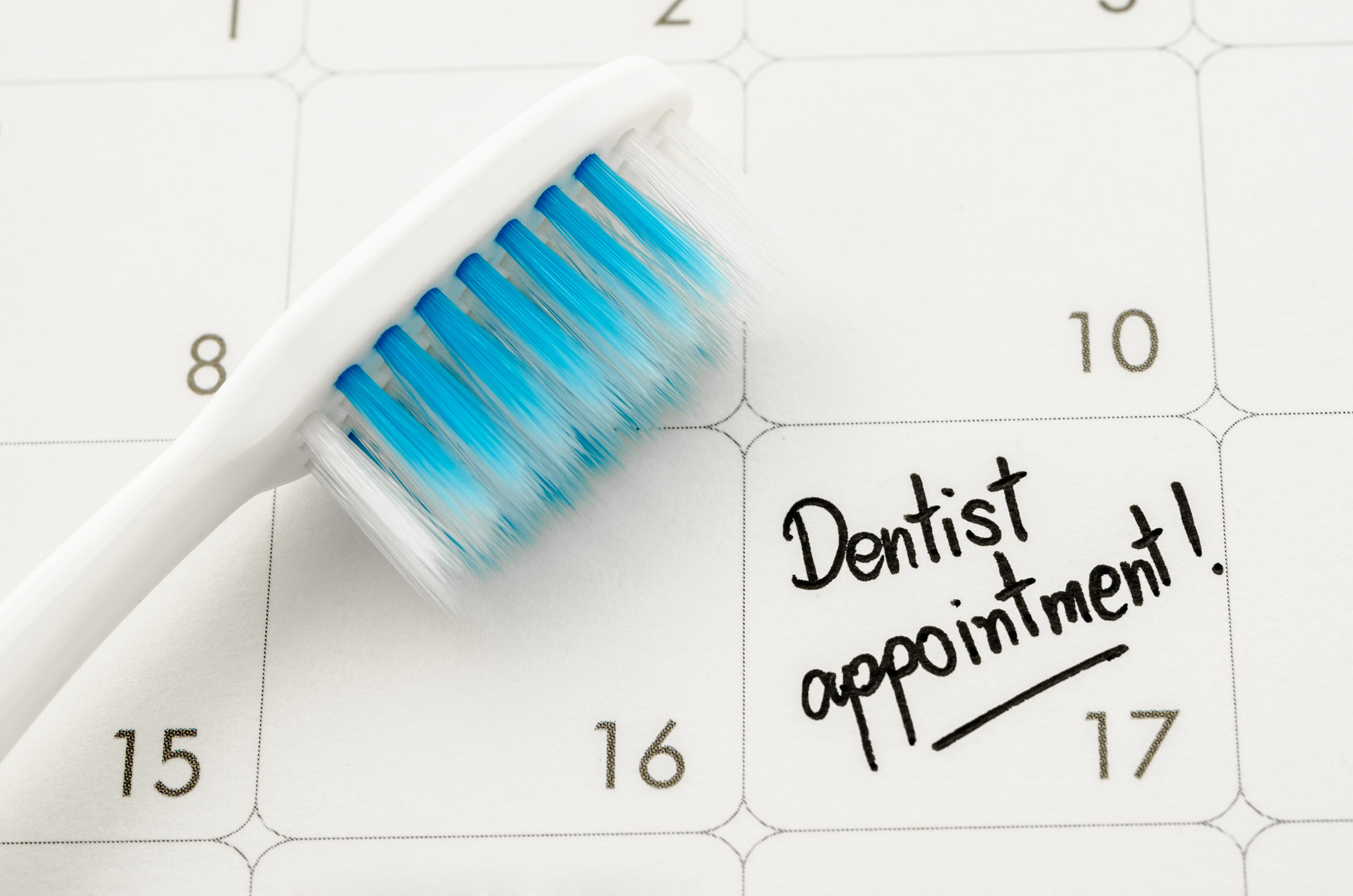 """reminder """"dentist appointment"""" in calendar with toothbrush."""