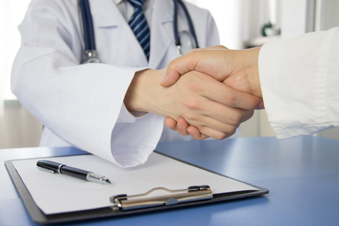 doctor-and-businessman-shaking-hands