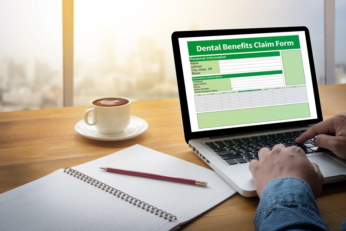 dental-benefits-claim-form-document-dental-computing-computer-flare-sun-cropped-image-male-freelance