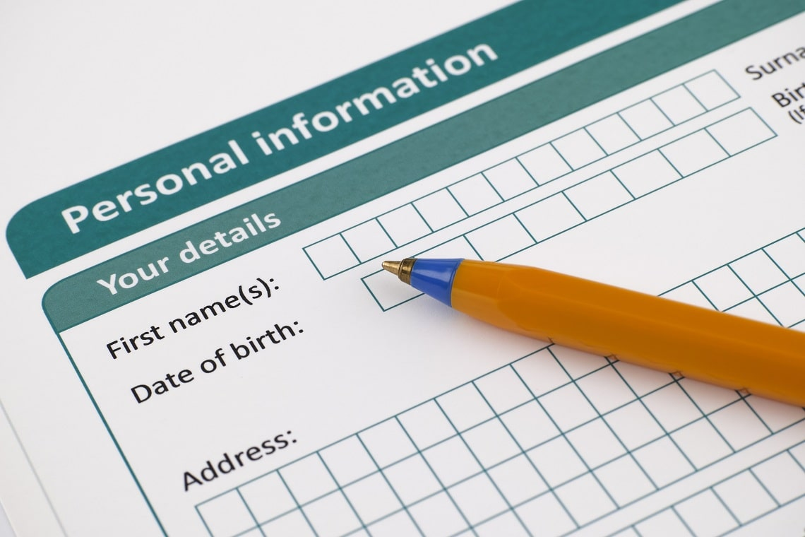 personal-information-form-with-ballpoint-pen