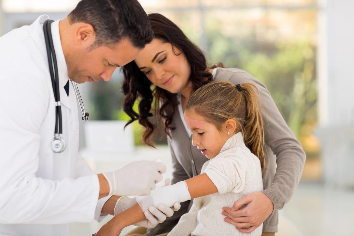 medical-doctor-bandaging-injured-patient-in-hospital