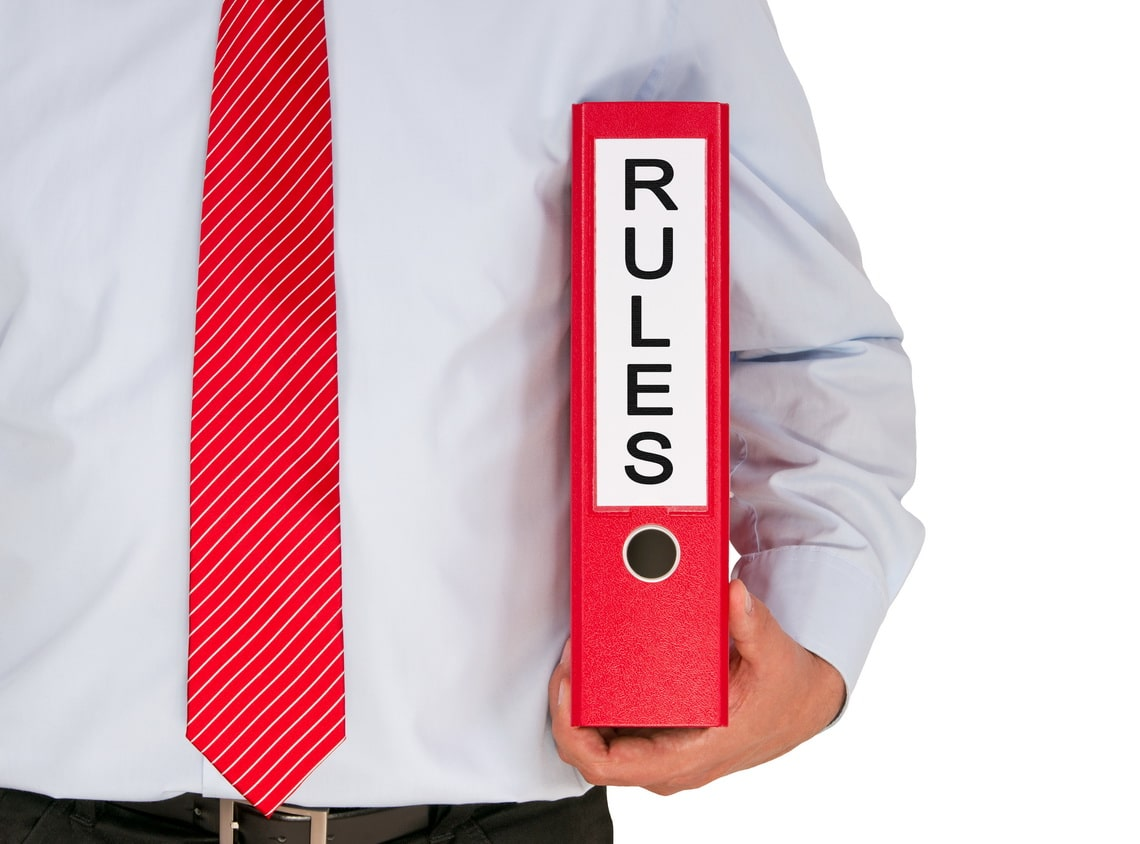 rules-businessman-with-binder