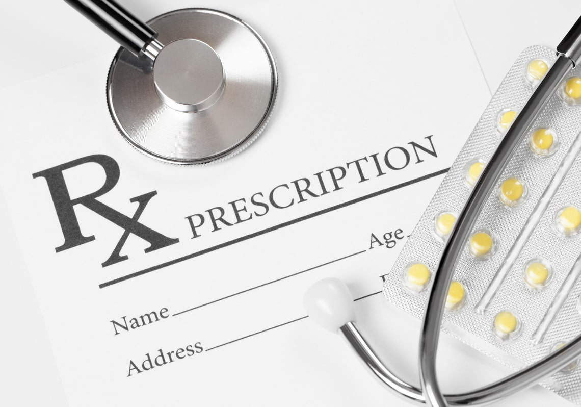 medicine-healthcare-and-all-things-related-prescription-form-with-stethoscope-over-it